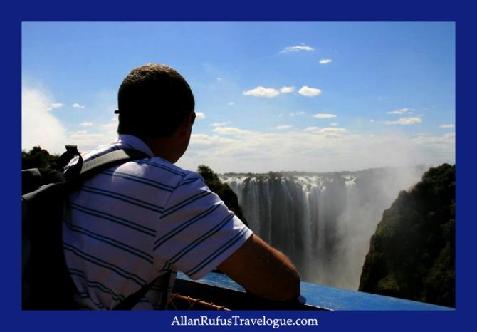 On the bridge between Zambia and Zimbabwe looking at Victoria Falls (Mosi-oa-Tunya)