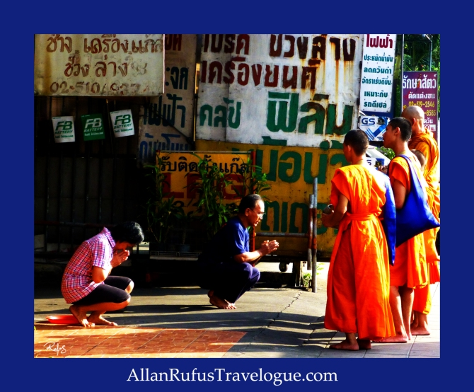 Young monks doing an alms prayer