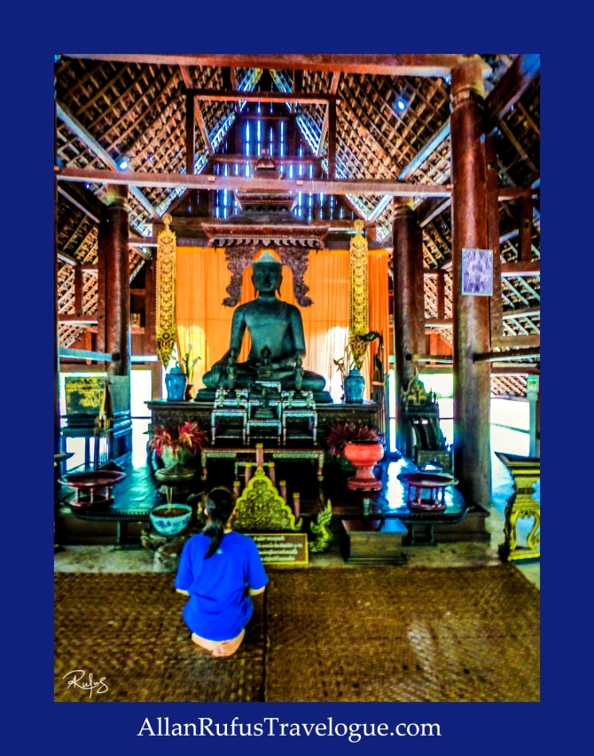 Praying in front of Buddha