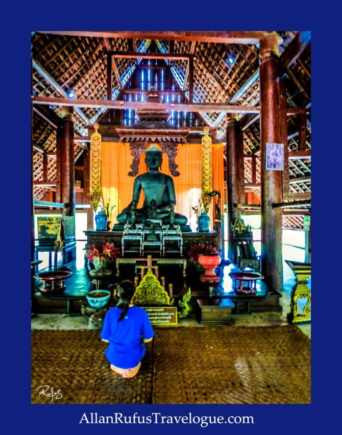 Praying in front of Buddha