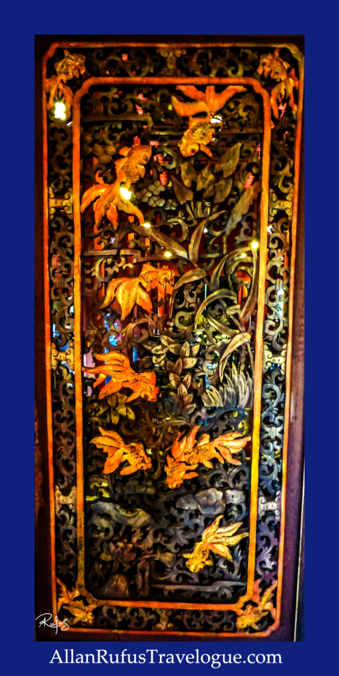 Wooden room divider with fish on it