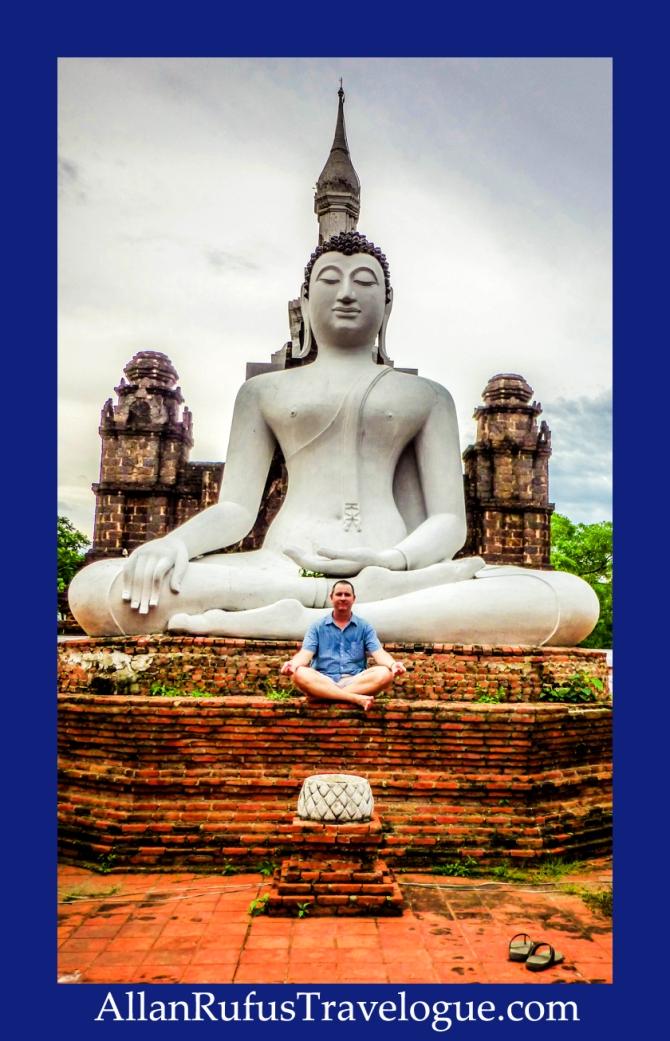 Meditating at the feet of Buddha