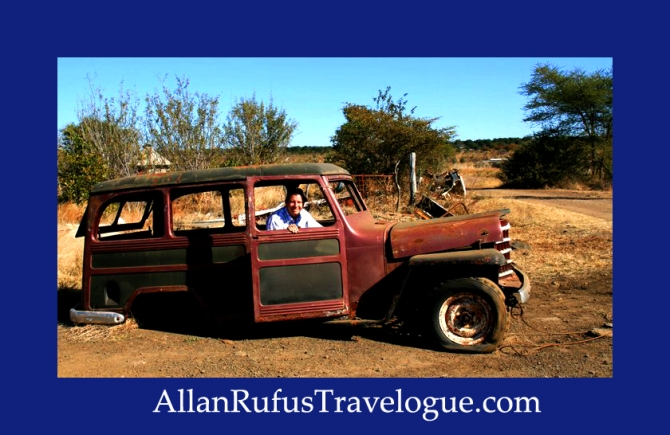 Travelogue - Allan Rufus. Botswana, Kasane, Me in a broken down scrapped car