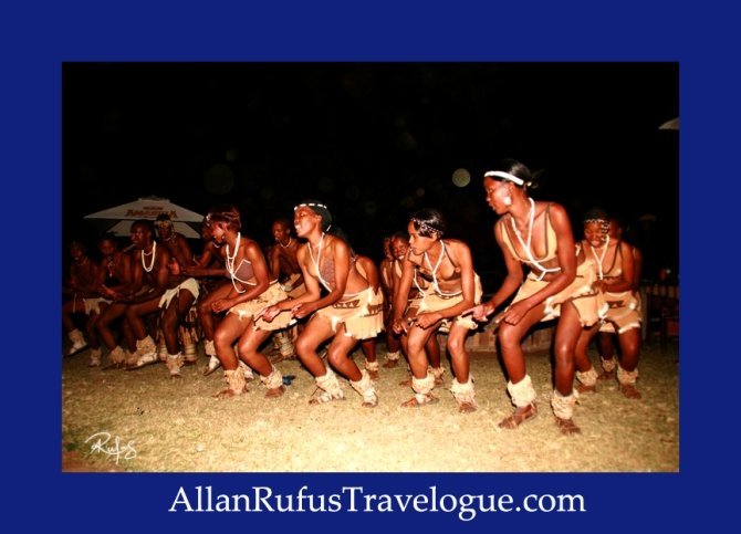 Travelogue - Allan Rufus. Botswana, Kasane, Motswana's putting on a African dance with lots of orbs around them enjoying the song and dance