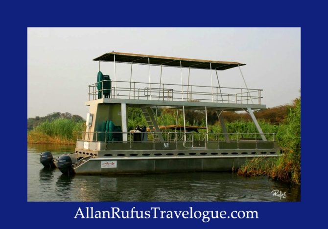 Travelogue - Allan Rufus. Botswana, Kasane, A double decker game viewing boat on the Chobe River