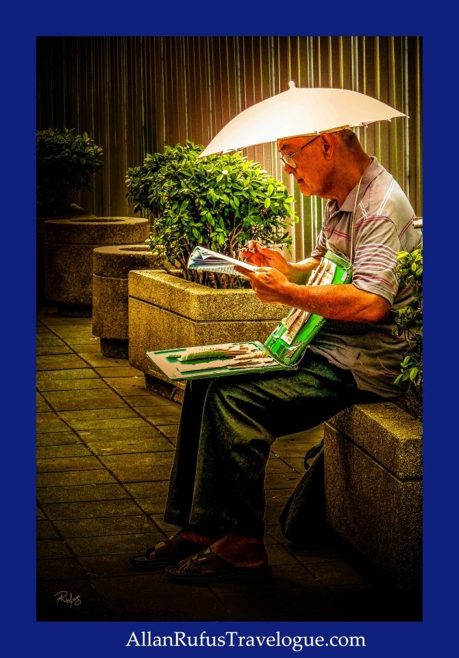 Street photography - Man doing a crossword while selling lottery tickets
