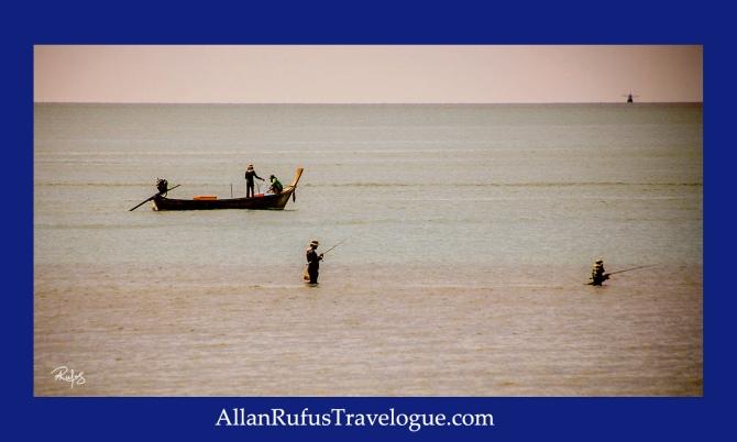 Thai fisherman wading in the sea!