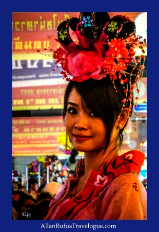 Street Photography -  A Thai Lady in costume!