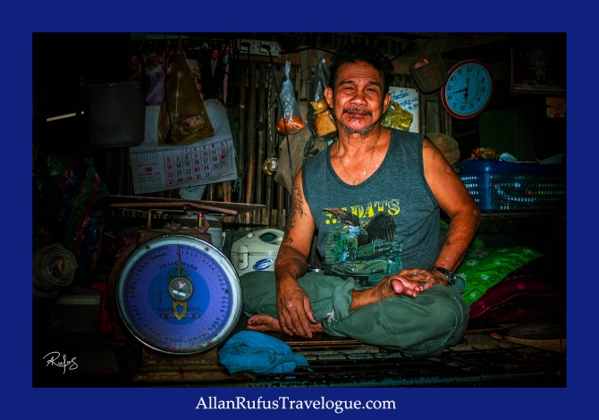Street Photography - Thai man in his market stall!