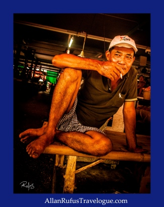 Street Photography - A Thai man smoking!