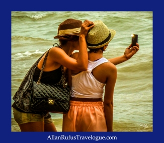 Street Photography - Ladies taking a selfie!