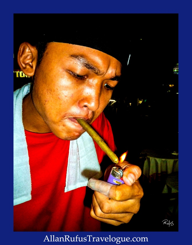 Street Photography - Lighting a cigar with a bic lighter!