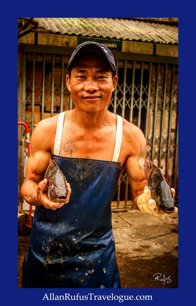 Street Photography - At the fish market - A man showing me his fish!