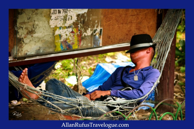 Street Photography - A man in a hammock sleeping and catching a few zzzz!