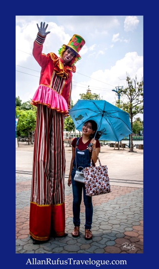 Street Photography - Stilts and an umbrella!