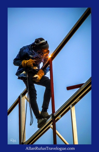 Street Photography - Welding up high!