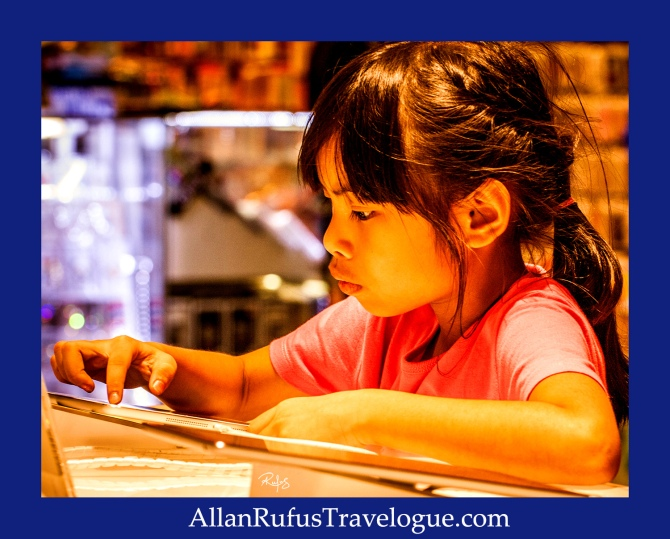 Street Photography - Young girl on an apple ipad