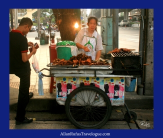 Street Photography - Buying chicken on a stick!