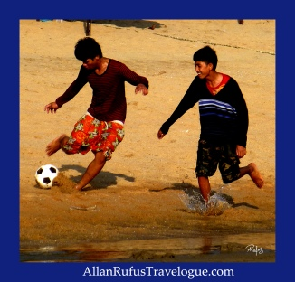 Street Photography - Playing football on the beach!